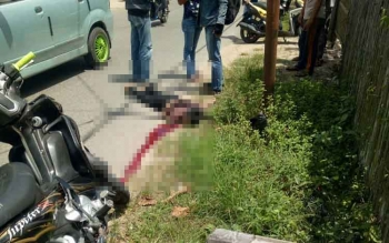 Samani (13) tergeletak pascatragedi lakalantas yang menimpanya.