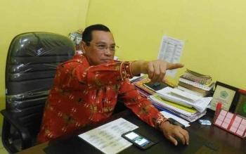Kepala Dinas Pendidikan Kabupaten Gunung Mas Agung.
