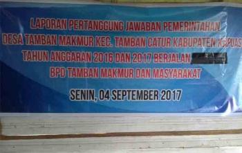 Spanduk kegiatan yang disiapkan BPD dalam rapat pertanggungjawaban Kepala Desa Tamban Makmur