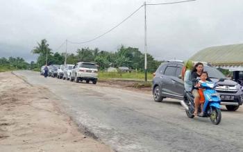 Suasana Desa Pudu ramai dengan arus lalu lintas
