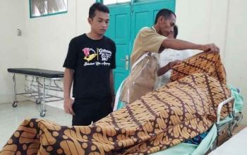 Jenazah Romadhon saat di kamar mayat RSUD dr Murjani Sampit.