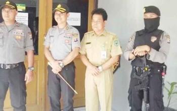 Saat Koordinasi Antara Kapolres Kapuas AKBP Sachroni Anwar SH S IK MH dan Kepala DPMDes Kapuas Drs Ibak di DPMDes Kabupaten Kapuas.