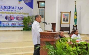 Kepala Dinas Kesehatan Kabupaten Barito Utara, Robansyah saat menyampaikan sambutan pada kegiatan pelayanan kesehatan, beberapa waktu lalu.