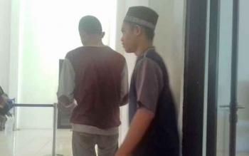 Muhammad Jepry Setiawan (16) dan Muhammad Nur Saputra alias Putra (16) usai jalani sidang.