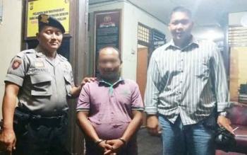 SU (43), pengedar zenith di warung Jalan Pemuda Km 30 Desa Muara Dadahup, Kecamatan Kapuas Murung.