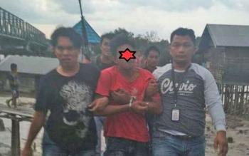 AN (23) saat diamankan jajaran Satreskrim Polres Kapuas.