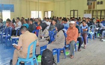 kegiatan rapat intensifikasi pajak daerah pajak sarang burung walet di gedung Lambang Batuah, Kecamatan Lahei.