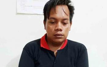 Kurir sabu, Febri Yanto, saat diamankan di Polres Palangka Raya.