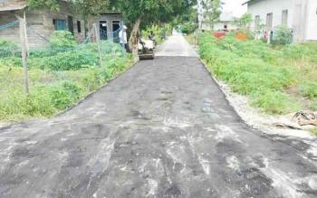 Proyek Peningkatan Jalan Lingkungan di Jalan Al Amin RT 02, Desa Sei Kapitan, Kecamatan Kumai.