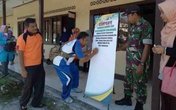 Lurah Padang, Dadang Suhendra menandatangani Kampanye Aplikasi Sistem Informasi Berkelanjutan GSI Menuju Sukamara Sakinah.