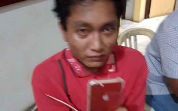 Adi, pelaku pencurian iphone 6s milik Dewi Astuti saat diamankan di Mapolres Kobar.