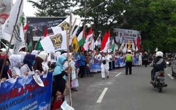 Aksi bela Palestina di Bundaran Besar, Kota Palangka Raya, Kalteng, Jumat (15/12/2017).