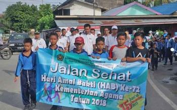 Jalan sehat yang diselenggarakan Kementerian Agama Barito Utara, Jumat (15/12/2017).