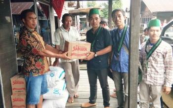 HMI Cabang Kapuas Salurkan Bantuan Korban Banjir Dadahub