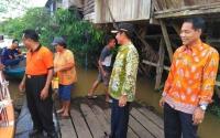 Bupati Gunung Mas Pantau Banjir di Kecamatan Tewah