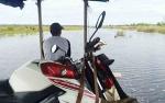 Luapan Air Sungai Katingan Juga Memutus Akses Jalan ke Talingke