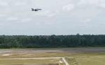 Elang 26 Terbang Rendah di Landas Pacu Lanud Iskandar