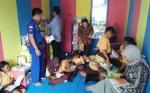 DPKD Sukamara Bantu Buku untuk Perpustakan Polair di Tepi Sungai