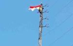 Dinas Kominfosandi Barito Utara Kibarkan Bendera pada Ketinggian 45 Meter
