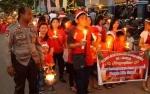 Pemuda Kristiani Lamandau Gelar Parade Lilin