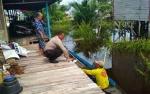 Bhabinkamtibmas Patroli Pantau Debit Air Waspadai Banjir