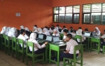 Pemkab Kotim Perhatikan SMP Masih Banyak Ujian Nasional Gunakan Kertas dan Pensil