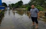 Anggota DPRD Gunung Mas Pantau Banjir di Tewah