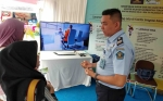 Kantor Imigrasi Dirikan Stan Layanan Penggantian Paspor pada Kalteng Quality Expo