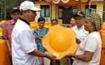 Warga Kecamatan Pulau Hanaut Mendapat Bantuan Tandon Air