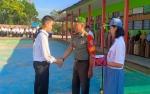 Denramil 07 Puruk Cahu Buka Masa Pengenalan Lingkungan Sekolah di SMAN 1 Murung