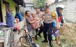 Kapolsek Pahandut Bantu Lansia 72 Tahun Berobat