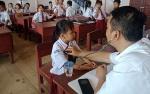 Puskesmas Puruk Cahu Gelar Penjaringan Kesehatan Anak Sekolah