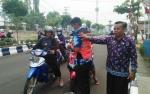 BPBD Barito Utara Bagikan Masker untuk Pengendara
