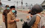 Pemkab Murung Raya Bersama Kejari Bagikan 4.000 Masker Gratis ke Masyarakat