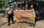 Anggota Polsek Pulau Petak Terus Sampaikan Imbauan Cegah Karhutla