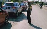 Parkir di Badan Jalan, Mobil Rental Milik Hakim Disarankan Gunakan Traffic Cone dan Lampu Lalu Lintas