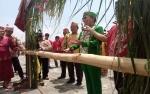 Kunjungan Ketua DAD Kalteng Disambut Upacara Potong Pantan di Gunung Mas