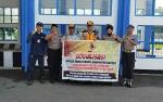 Polsek Kapuas Timur Sosialisasikan Pencegahan Pungli di Jembatan Timbang Anjir