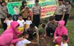 Polres Kapuas Tanam Ratusan Pohon Dukung Penghijauan