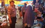 Polsek Kapuas Timur Laksanakan Pengamanan di Pasar Tradisional Mingguan
