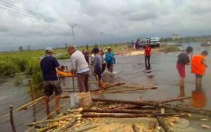 Banjir Memutus Akses Jalan Menuju Petak Bahandang Katingan