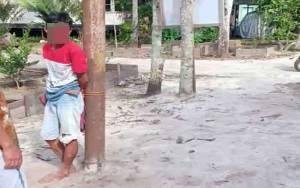 Warga Pukuli dan Ikat Pelaku Pencurian dan Penganiayaan di Tiang Listrik