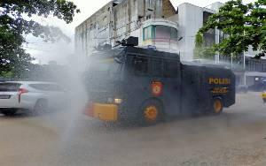 Setiap Hari Polres Kotim Semprotkan Disinfektan di Jalan Protokol Sampit