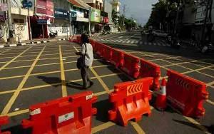 Timang-Timang Opsi Karantina Wilayah untuk Cegah Corona