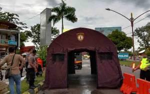 Ditsabhara Polda Kalteng Dirikan Tenda Penyemprotan Disinfektan di Palangka Raya
