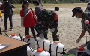 Anggota Koramil Tumbang Talaken Semprot Disinfektan Cegah Covid-19