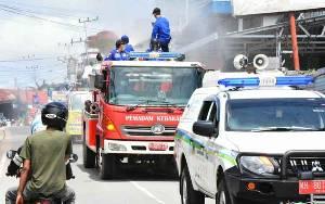 Tim Gugus Tugas Corona Barito Utara Lakukan Penyemprotan Pada Area Publik