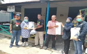 DPW Nasdem Kalteng Bagikan Sembako kepada Warga Kurang Mampu