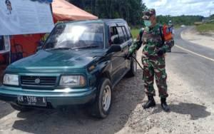 Koramil Tumbang Talaken SemprotDisinfektan di Posko Perbatasan Palangka Raya - Gunung Mas