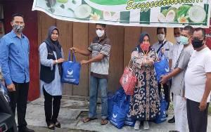 Partai Nasdem Bagikan Sembako kepada 4 Kelompok di Kelurahan Panarung